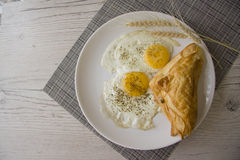 Fried eggs and snack Stock Photo