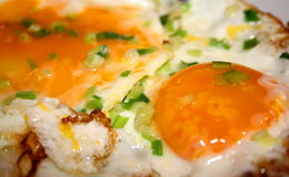 Fried eggs - sunny side up. A close up of two fried eggs, sunny side up, garnished with chopped green onions Stock Photography