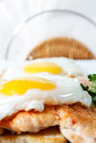 Fried eggs with toast and chicken Royalty Free Stock Photos