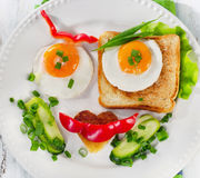 Fried eggs with toast and vegetables Stock Image