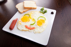 Fried eggs, toasts and Sausage Stock Photo