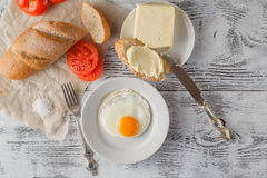 Fried eggs with toasts Stock Photography