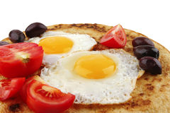 Fried eggs with tomato Royalty Free Stock Images