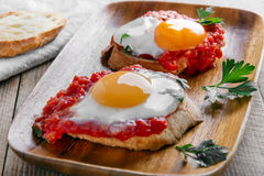 Fried eggs in tomato sauce Royalty Free Stock Photos