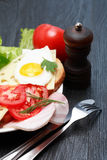Fried Eggs With Tomatoes Stock Photo