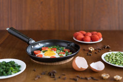 Fried eggs with tomatoes Royalty Free Stock Photography