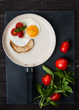 Fried eggs, tomatoes and toast for Breakfast. Breakfast Fried eggs, tomatoes and toast royalty free stock images