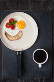 Fried eggs, tomatoes and toast for Breakfast. Eggs, tomatoes and toast for Breakfast Royalty Free Stock Images