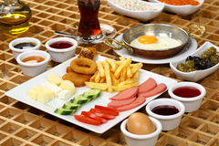 Fried eggs and Turkish Breakfast Plate. Rich and delicious breakfast table Stock Photos