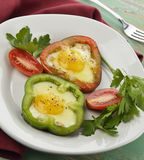 Fried Eggs With Vegetables Stockbild
