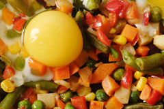 Fried eggs with vegetables. Royalty Free Stock Photography