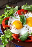 Fried eggs with vegetables for breakfast Royalty Free Stock Photos