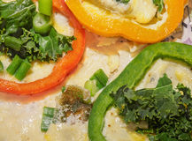 Fried eggs with vegetables Stock Photo