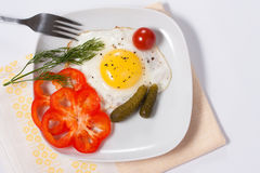 Fried eggs with vegetables and greens. Fried eggs with salty vegetables and greens Stock Photo