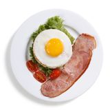 Fried eggs with vegetables and ham  Stock Image
