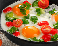 Fried eggs and vegetables Stock Image