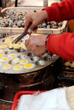 Fried eggs vendor Stock Photo