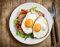Fried eggs on white plate Royalty Free Stock Image