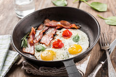 Free Fried Eggs With Bacon Royalty Free Stock Photography - 56398737
