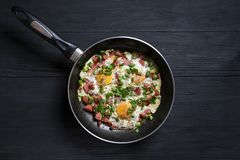 Fried eggs on a wooden background with place for copy space. Fried eggs on a wooden background stock photos