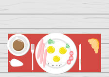 Fried eggs on a wooden table vector greens Royalty Free Stock Photography