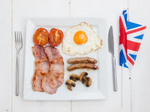 Fried english breakfast with british flag Stock Photo