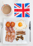 Fried english breakfast with british flag and tea Royalty Free Stock Photography