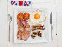 Fried english breakfast with union jack Royalty Free Stock Photography