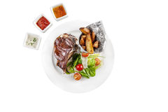 Fried entrecote with French fries on the white plate stock images