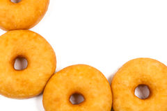 Fried equal round doughnuts in frame Stock Images