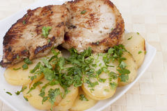 Fried escalope of pork. With potatoes Royalty Free Stock Image