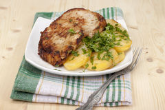 Fried escalope. Of pork with potatoes Royalty Free Stock Images