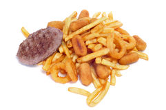 Fried and fattening food. Closeup of a pile of fried and fattening food on a white background stock photos