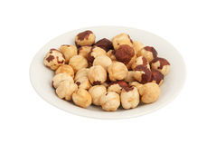 Fried filbert. Fried nuts of a filbert on a plate. On a white background Royalty Free Stock Image