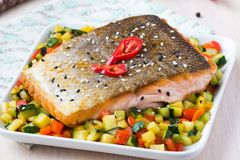 Fried fillet of red fish salmon with crispy skin, roasted. Vegetables, zucchini, pepper, beautiful dish Royalty Free Stock Image
