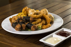 Fried finger food. A hortizontal shot of a plate of fried finger food snack ready to be served Royalty Free Stock Images
