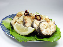 Fried fish. Slices of fried hake whit lemon stock photos