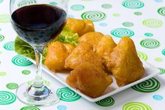 Fried fish. With salad and glass of red wine Royalty Free Stock Image