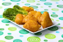 Fried fish. Fried fresh fish with salad Royalty Free Stock Photography