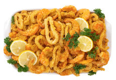 Fried Shrimp and Calamari with Lemon. Breaded and deep fried Shrimp and Calamari with lemon slices Stock Photo