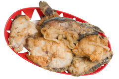 Fried fish. On a table there is in a red vase a fried fish Stock Image