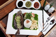 Grilled or fried fish asian style Stock Image