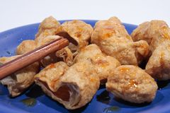 Fried fish balls with chopsticks. Stock Photo
