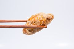Fried fish balls with chopsticks. Royalty Free Stock Photo