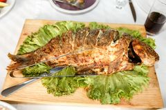 Fried fish on a banquet table in a restaurant. Fried fish close up on a banquet table in a restaurant Royalty Free Stock Photo