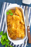 Fried fish in a batter. On a table stock photography
