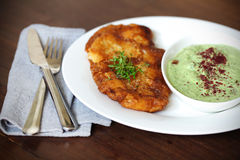 Fried fish in beer batter with cucumber yoghurt dip and sumac Royalty Free Stock Image