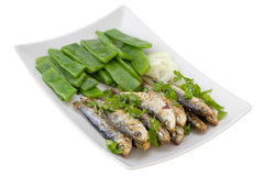 Fried fish with boiled beans Royalty Free Stock Images
