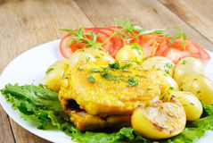 Fried fish with boiled new potatoes Stock Images