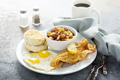 Free Fried Fish Breakfast With Sunny Side Up Eggs Stock Photography - 112706712